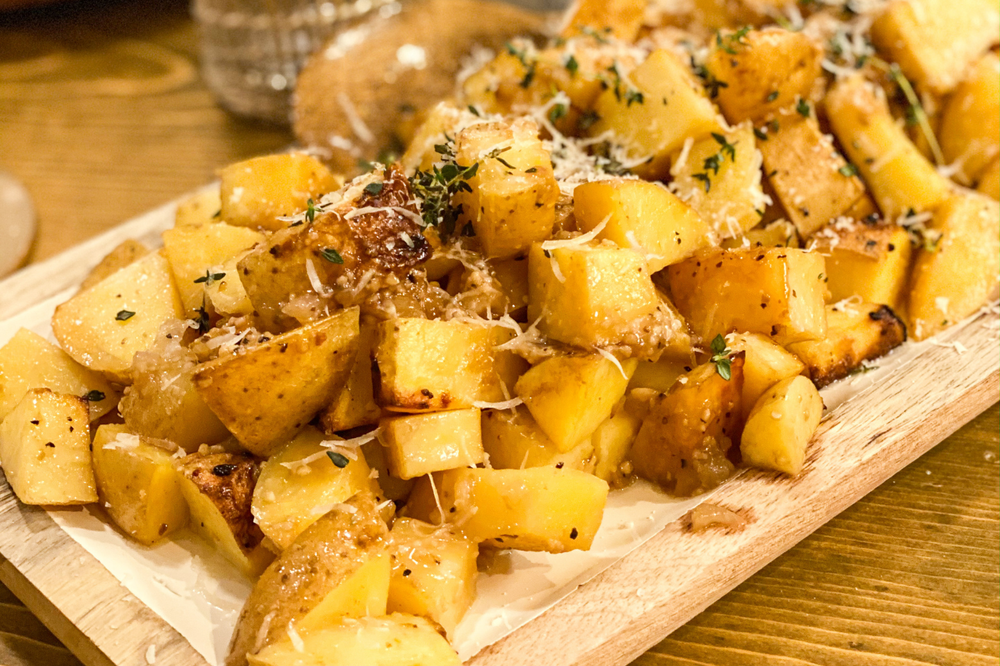 roasted potatoes on a cutting board