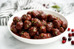 A bowl of cranberry meatballs