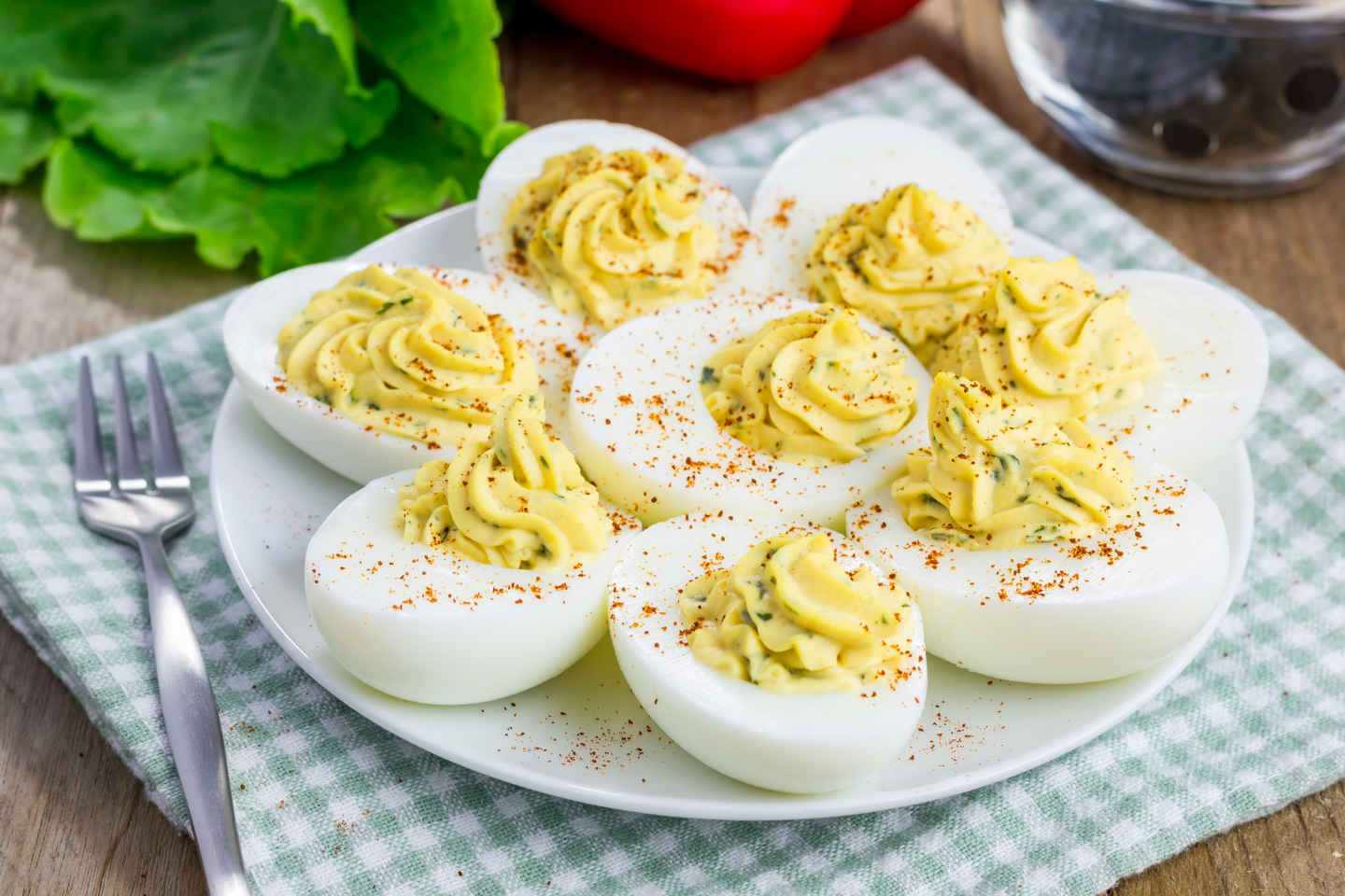 Deviled eggs on plate with blue and white checkered placemat